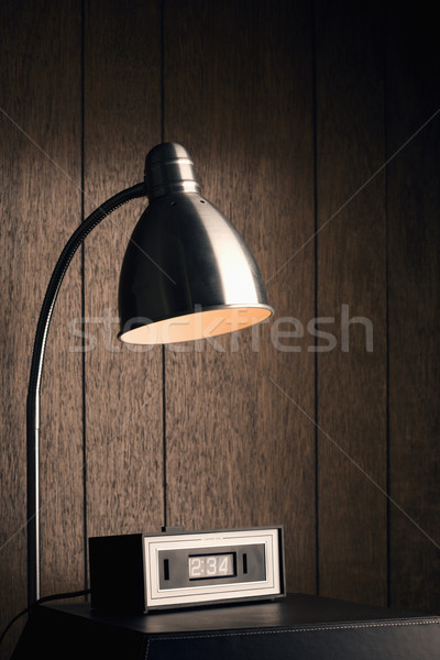 Desk lamp and retro clock. Stock photo © iofoto