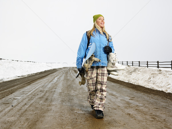Woman carrying snowboard. Stock photo © iofoto