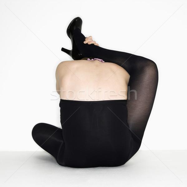 Woman attempting stretch, Stock photo © iofoto