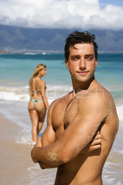 Man posing on beach. Stock photo © iofoto