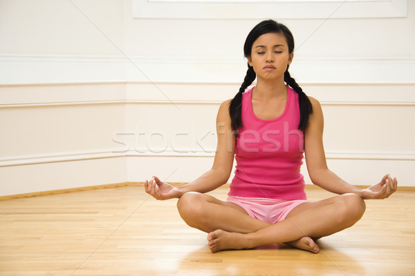 Woman in lotus pose Stock photo © iofoto