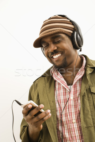 Man with mp3 player. Stock photo © iofoto
