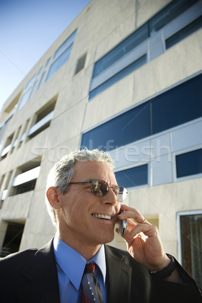 Man talking on cellphone. Stock photo © iofoto