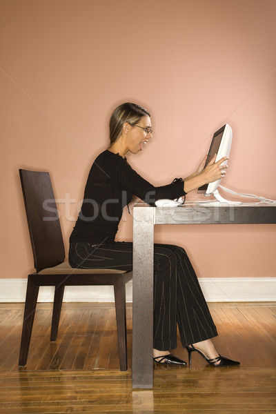 Attractive Young Businesswoman Looking at Computer Surprised Stock photo © iofoto