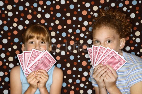 Girls holding playing cards. Stock photo © iofoto
