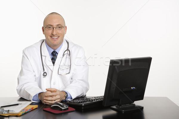 Erkek kafkas doktor yetişkin doktor oturma Stok fotoğraf © iofoto