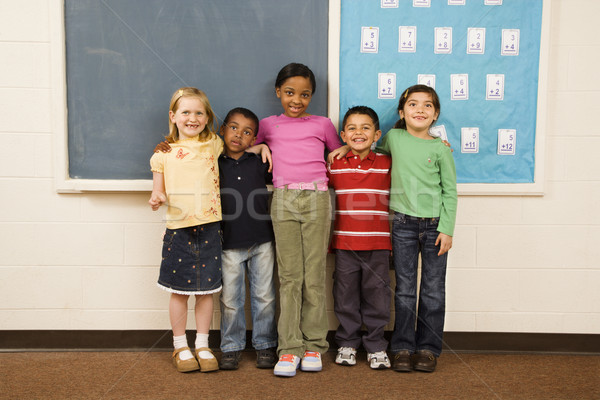 Students Standing in Classroom.  Stock photo © iofoto