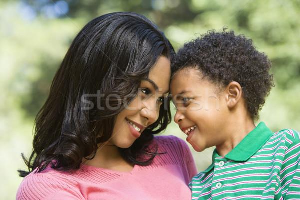 Anya fiatal fiú tart néz szemek Stock fotó © iofoto