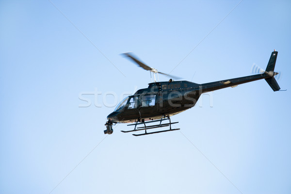 Black helicopter flying through the air. Stock photo © iofoto