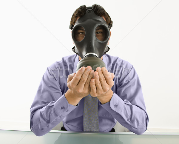Man wearing gas mask with hands over mouth. Stock photo © iofoto