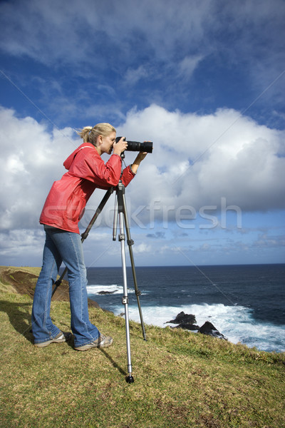 Woman photographing scenery. Stock photo © iofoto