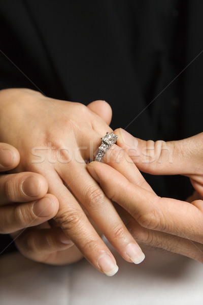 Man putting ring on woman. Stock photo © iofoto