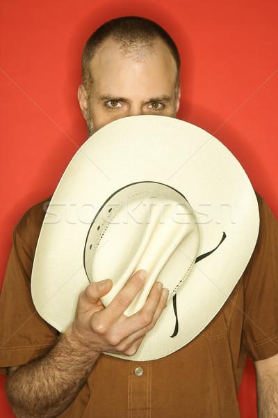 Stock fotó: Kaukázusi · férfi · cowboykalap · részben · arc · narancs