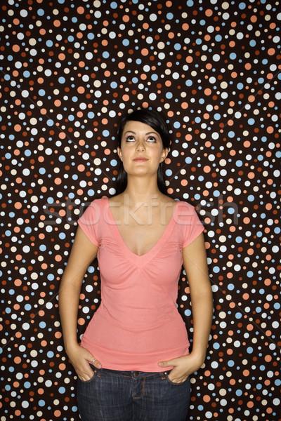 Woman on polka dot background. Stock photo © iofoto