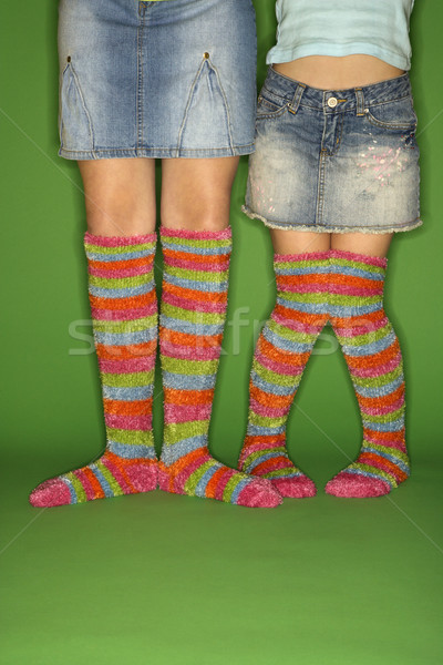 Caucasian female children wearing striped socks. Stock photo © iofoto