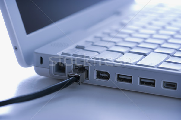 Data wire to laptop computer. Stock photo © iofoto