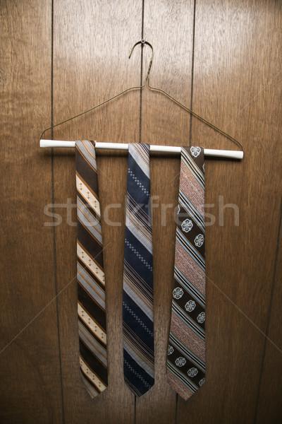 Neckties on clothes hanger. Stock photo © iofoto
