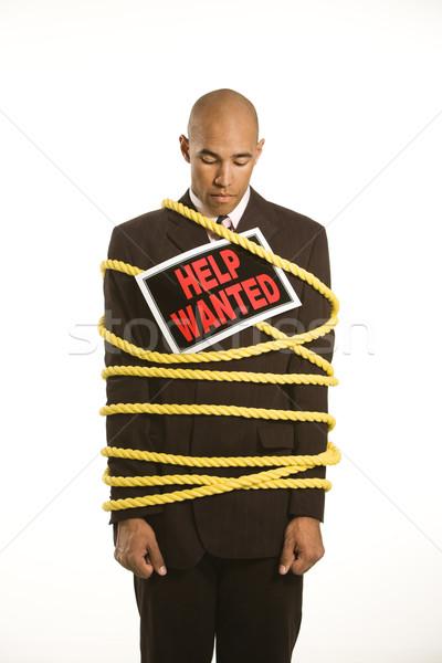 üzletember kötél afroamerikai citromsárga visel segítség Stock fotó © iofoto