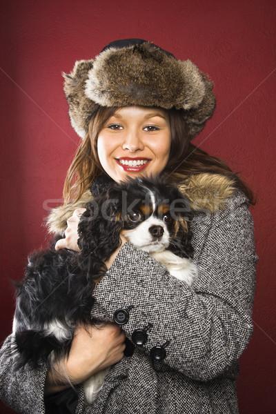 Woman holding dog. Stock photo © iofoto