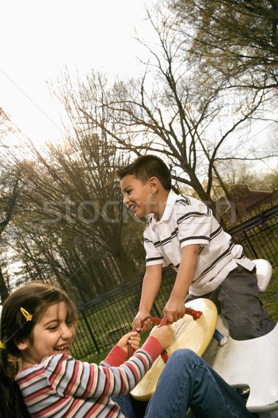 Giovane ragazza ragazzo giocare altalena ragazza fuori Foto d'archivio © iofoto