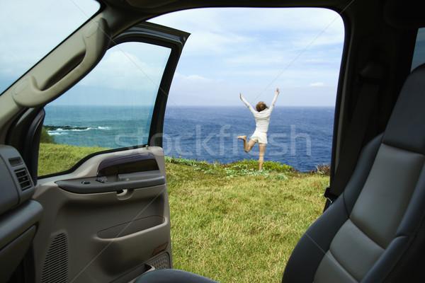 Happy woman near ocean. Stock photo © iofoto