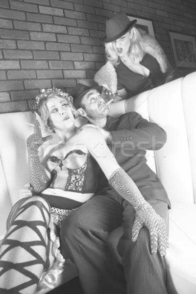 Retro man with two women. Stock photo © iofoto