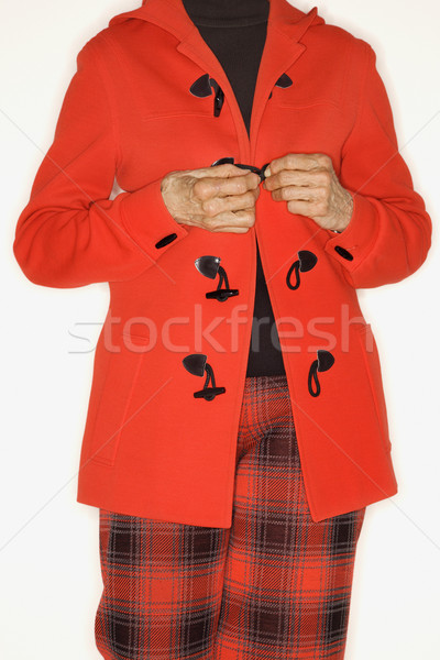 Woman buttoning coat. Stock photo © iofoto