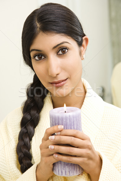 Young woman holding candle. Stock photo © iofoto