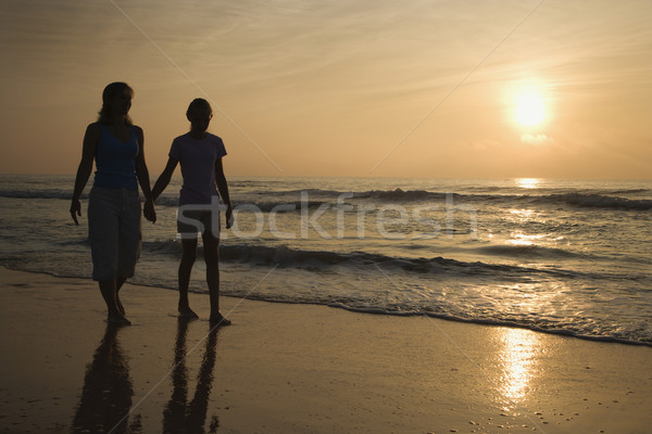 Mom and daughter at sunrise. Stock photo © iofoto