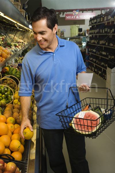 Homme épicerie Shopping Homme fruits Photo stock © iofoto