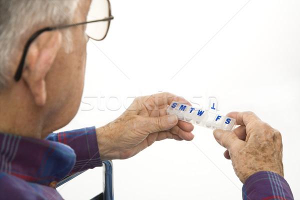 Man holding pill organizer. Stock photo © iofoto