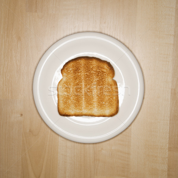 Slice of toast on plate. Stock photo © iofoto