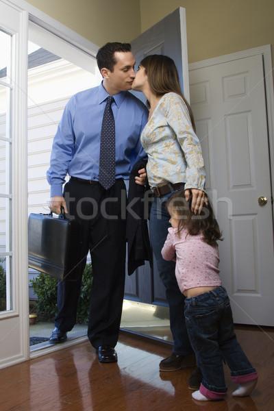 Empresário trabalhar caucasiano abrir a porta beijando esposa Foto stock © iofoto