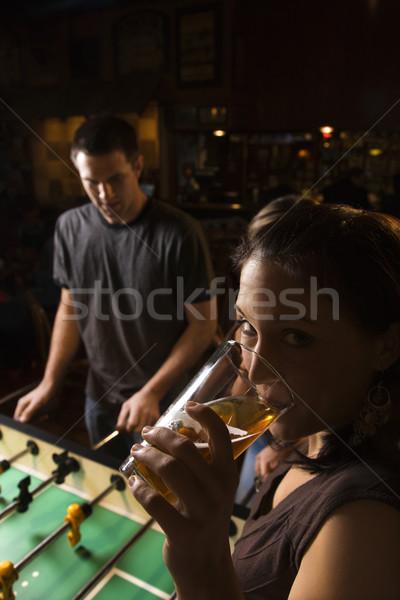 Woman drinking beer. Stock photo © iofoto
