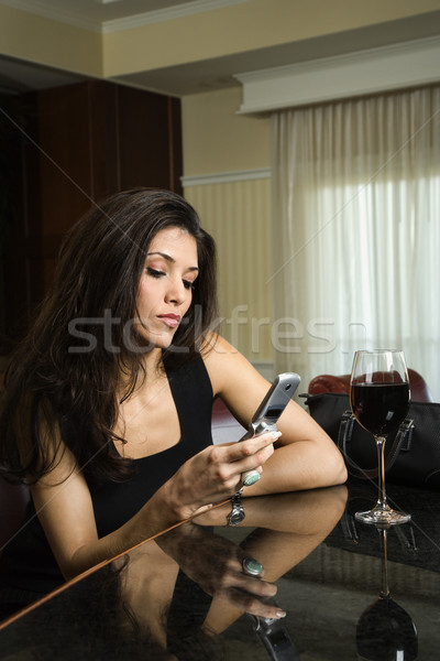 Woman on cellphone at bar. Stock photo © iofoto