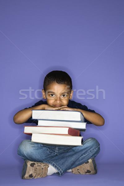 Boy sitting with books. Stock photo © iofoto