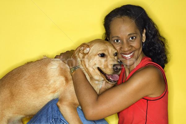 улыбающаяся женщина собака афроамериканец взрослый женщины цвета Сток-фото © iofoto