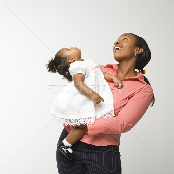 Woman holding infant girl. Stock photo © iofoto