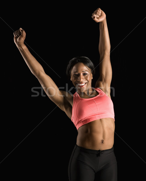 Strong woman stretching. Stock photo © iofoto