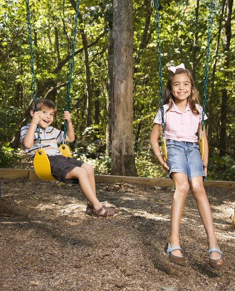 Enfants Swing hispanique garçon fille Photo stock © iofoto