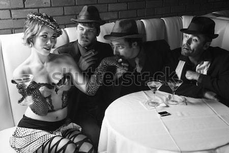 Retro woman drinking martini. Stock photo © iofoto