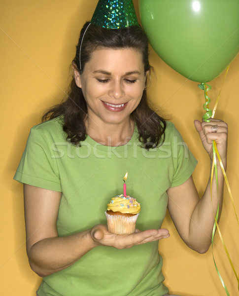 Woman holding birthday cupcake. Stock photo © iofoto