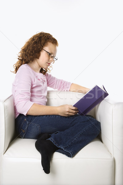 Girl sitting reading book. Stock photo © iofoto