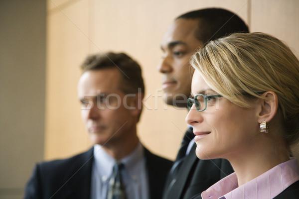 Három üzletemberek közelkép kaukázusi üzletasszony kettő Stock fotó © iofoto