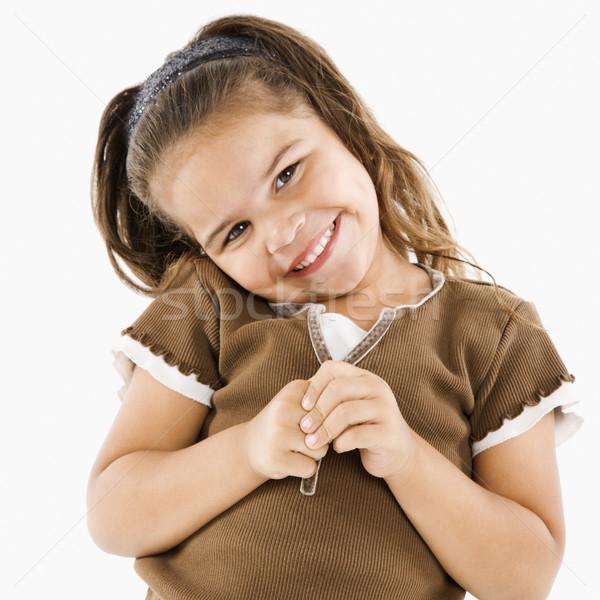 Pequeño sonriendo hispanos nina cute pie Foto stock © iofoto