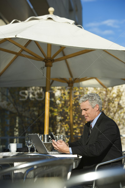 Businessman with laptop. Stock photo © iofoto