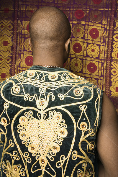 Man in embroidered vest. Stock photo © iofoto