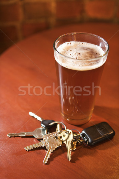 Glass of Beer and Keys on Bar Table Stock photo © iofoto