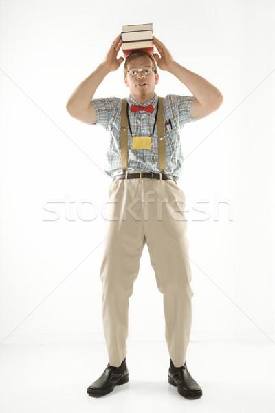 Man balancing books. Stock photo © iofoto