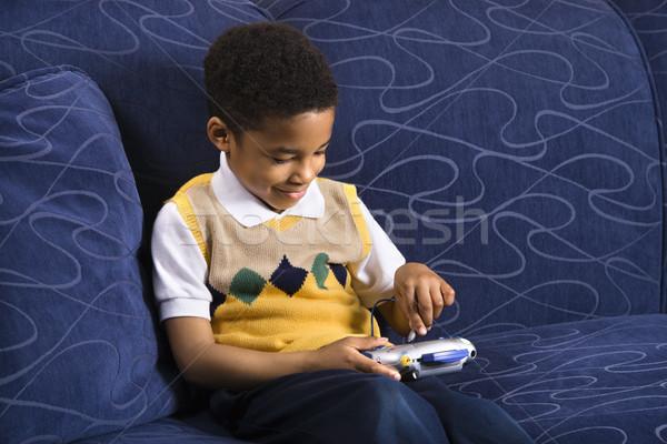 Fiú játszik videojáték portré fiatal srác kanapé Stock fotó © iofoto